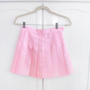 Pink pleated mini tennis skirt